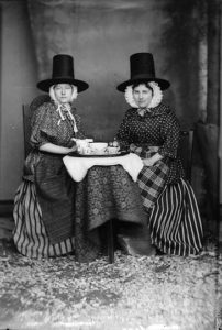 two_women_in_national_dress_drinking_tea_jones_nlw3363089